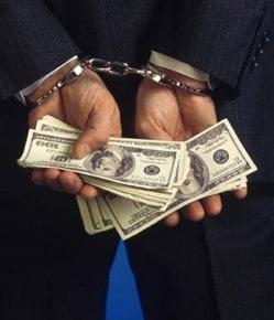 hands-handcuffs-cash